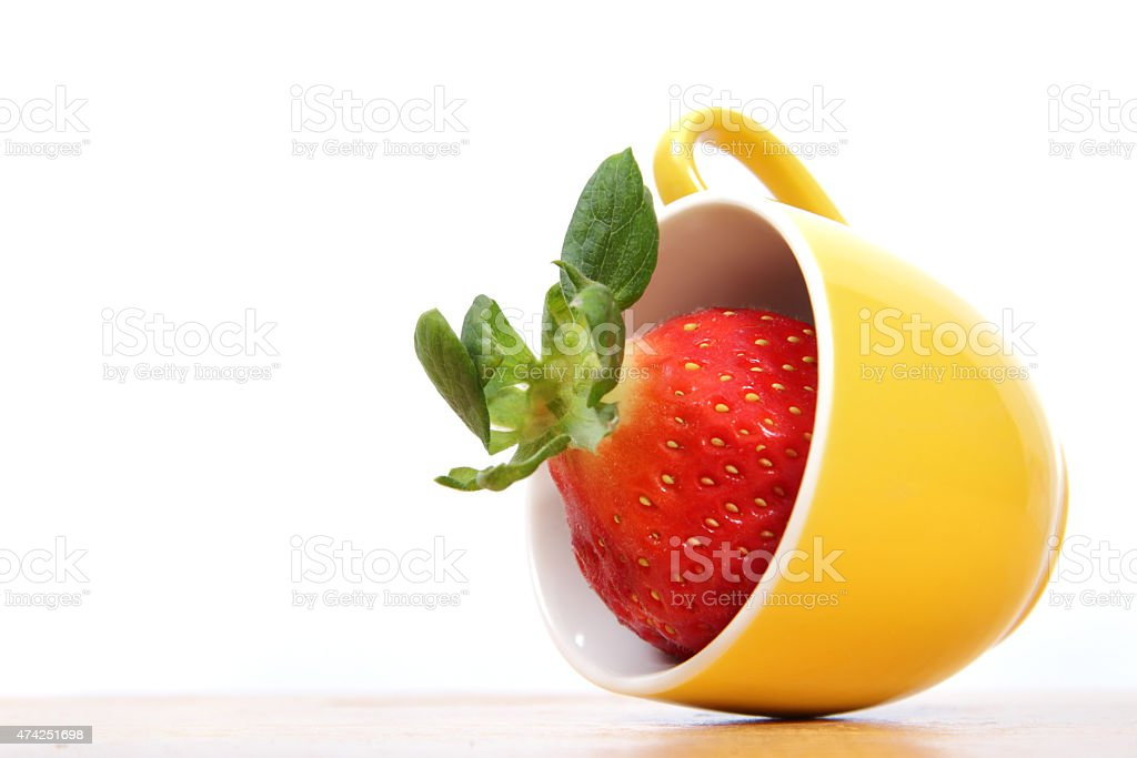 Red strawberry in yellow cup stock photo