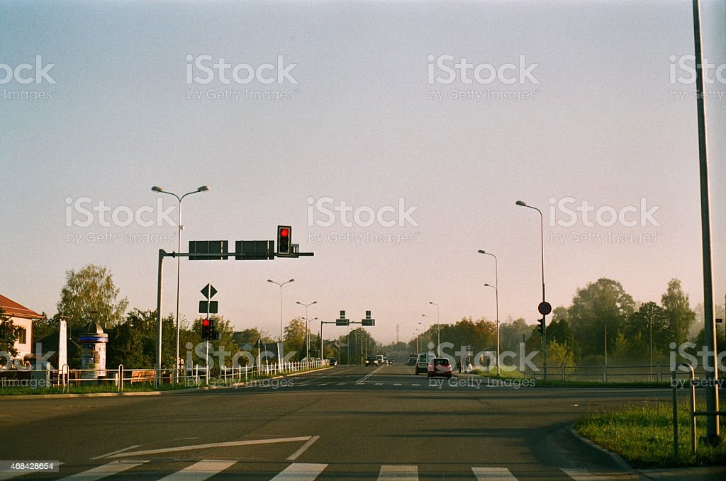 Red street lights in suburbia, early morning. stock photo