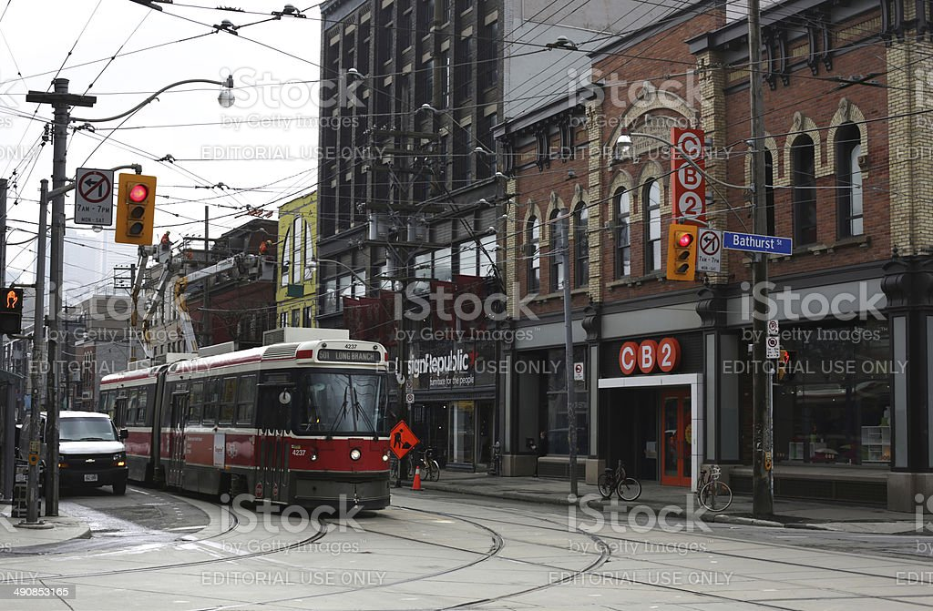 Red Streetcar Travels Queen Street West, Toronto in Spring stock photo