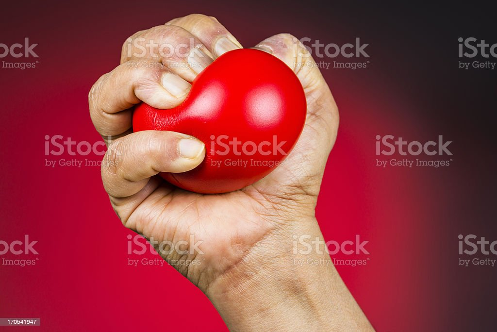 Red stress ball in hand royalty-free stock photo