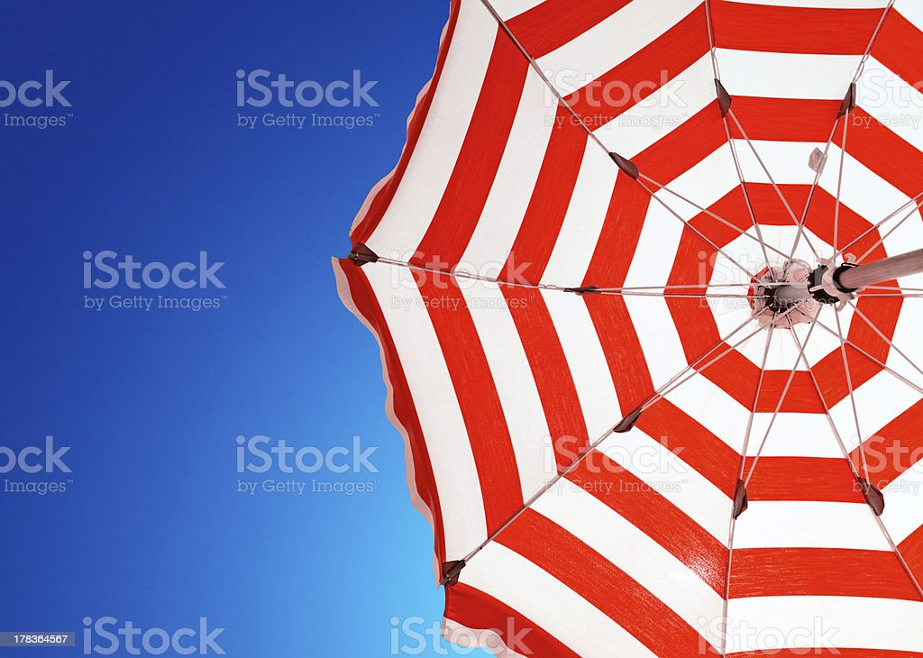 Red stripe umbrella stock photo