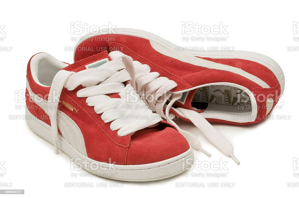 Red Suede Puma Shoes with Fat Laces Isolated stock photo