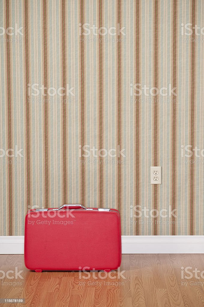 Red Suitcase In Empty Room. royalty-free stock photo