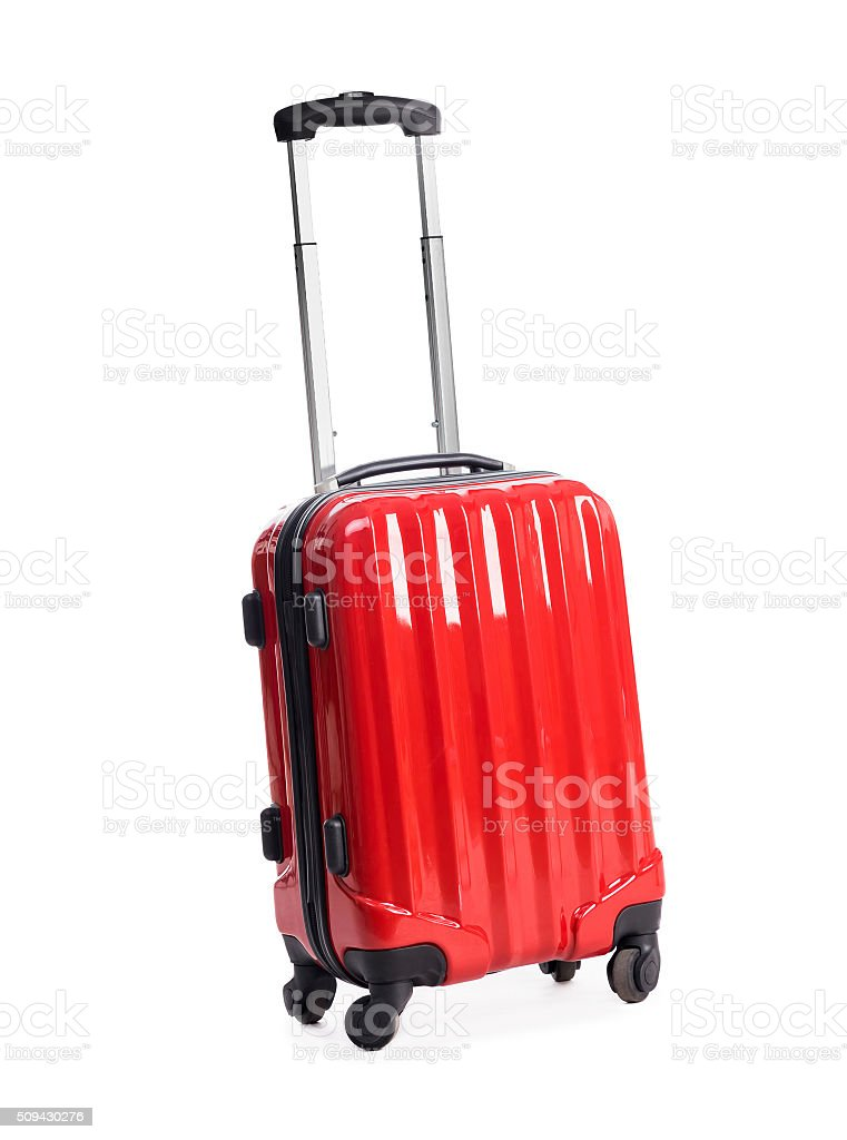 red suitcase on white stock photo