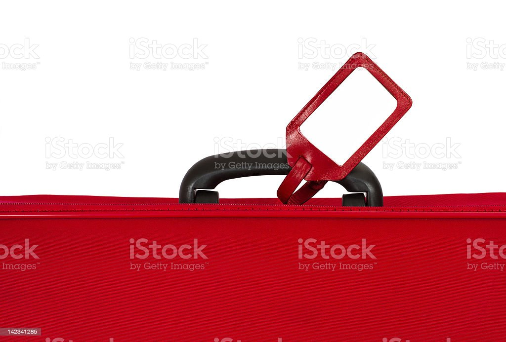 Red suitcase with blank identification tag stock photo