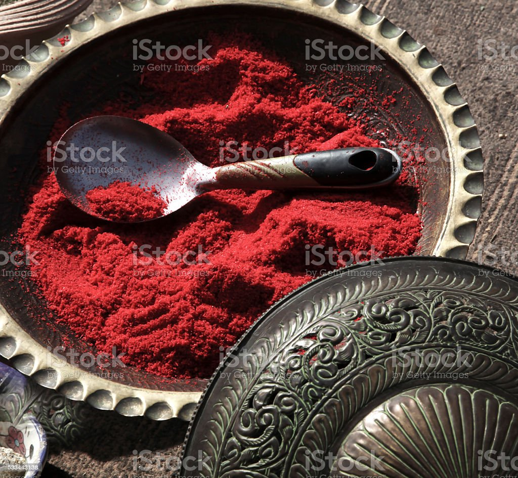 Red sumac spice in ornate middle eastern bowl stock photo