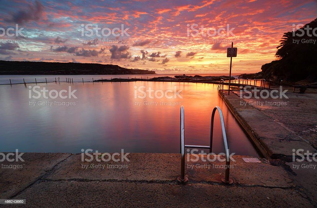 Red Summer Sunrise over Malabar Ocean Rockpool Long Bay Australia stock photo
