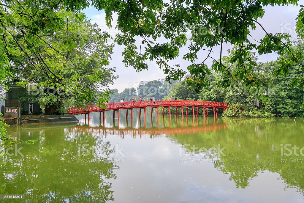 Red Sunbeam Huc Bridge in Hoan Kiem Lake, Hanoi, Vietnam stock photo