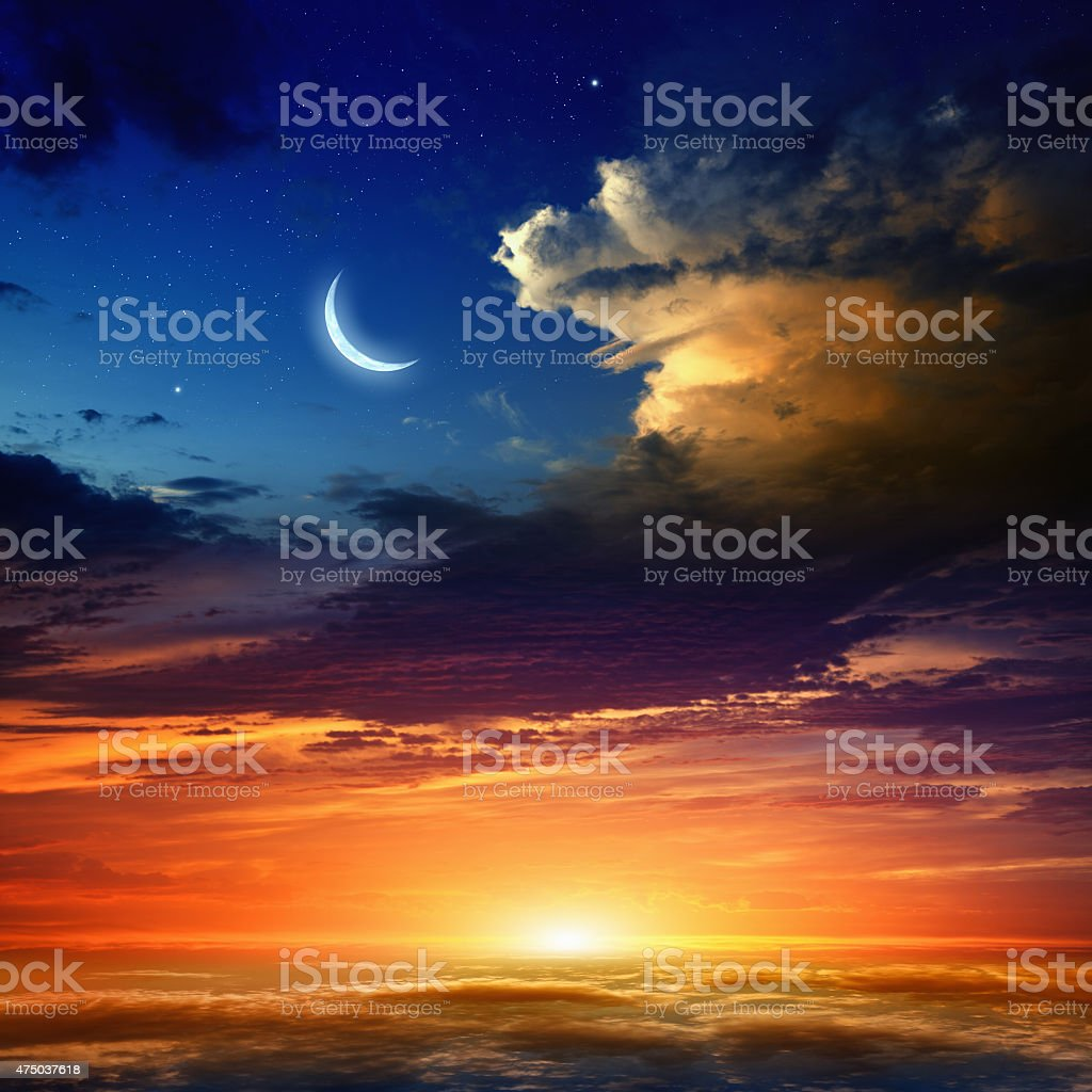 Red sunset and moon stock photo