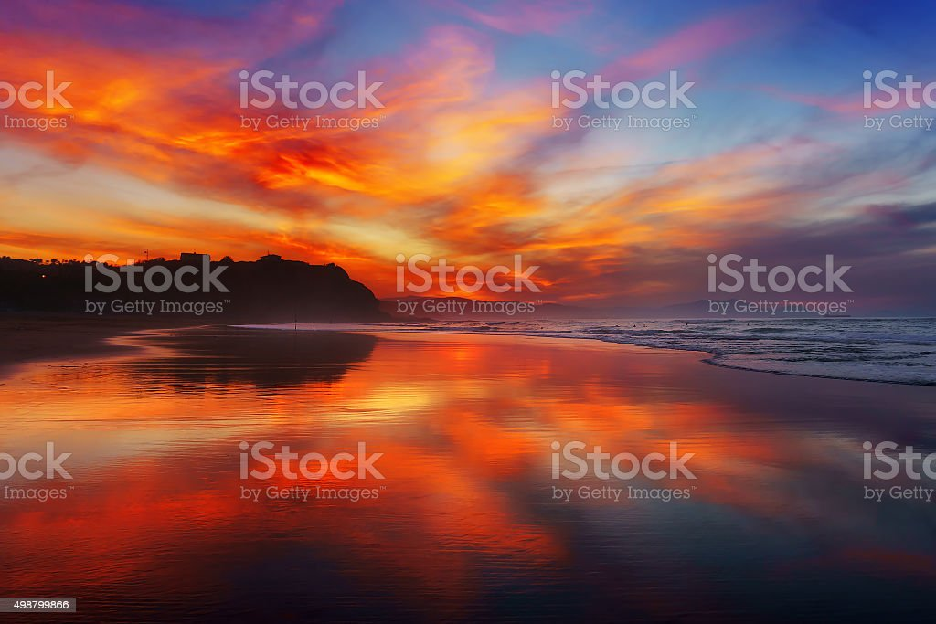 red sunset in Sopelana beach stock photo