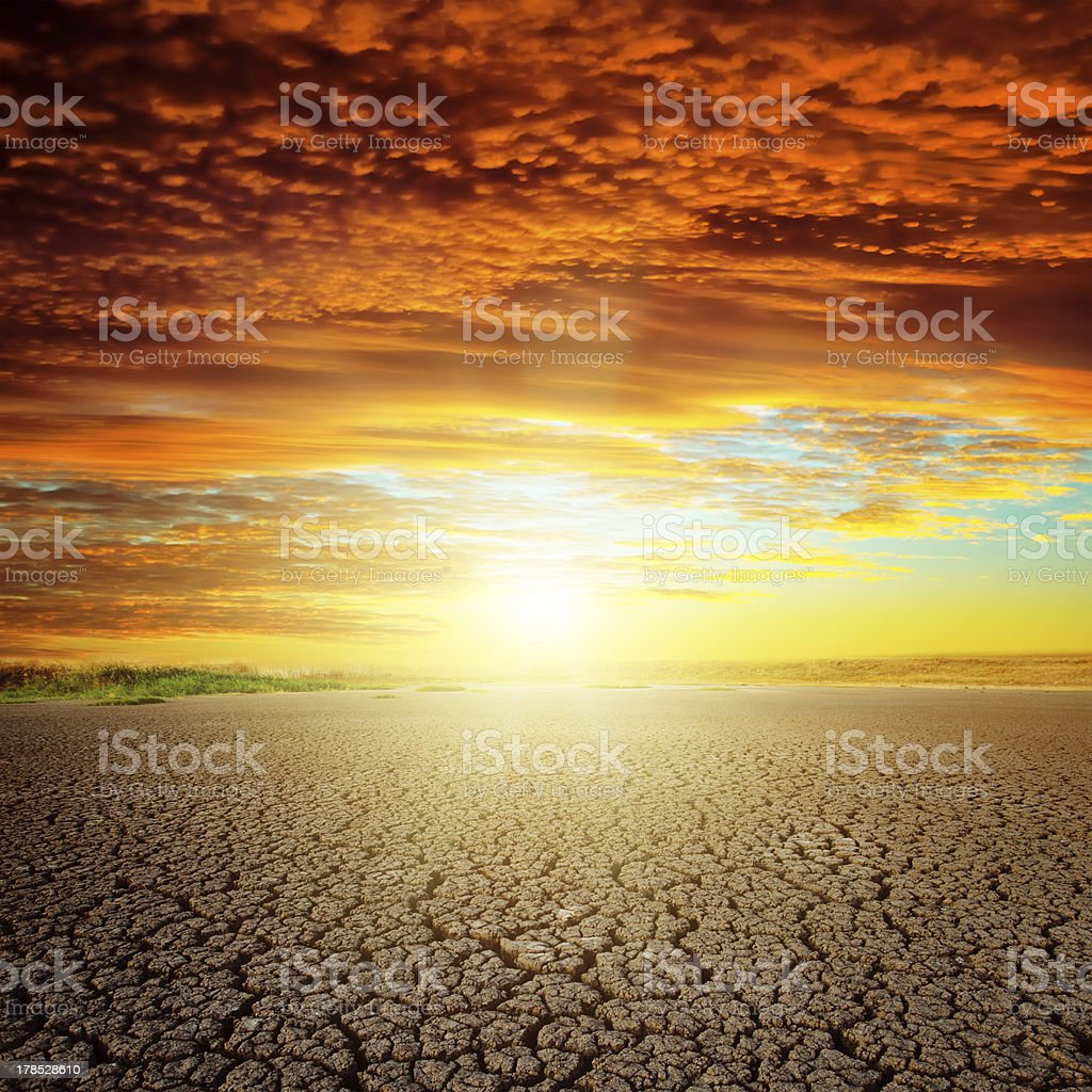 red sunset over drought eart royalty-free stock photo