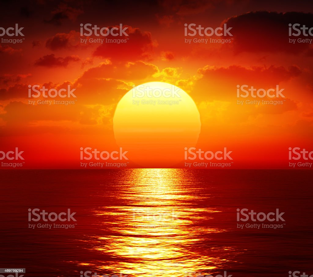 red sunset over ocean stock photo