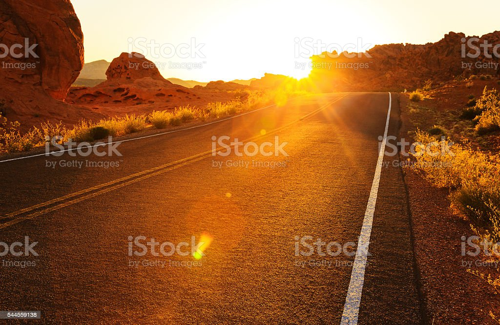 Red sunset over road, southern Nevada stock photo