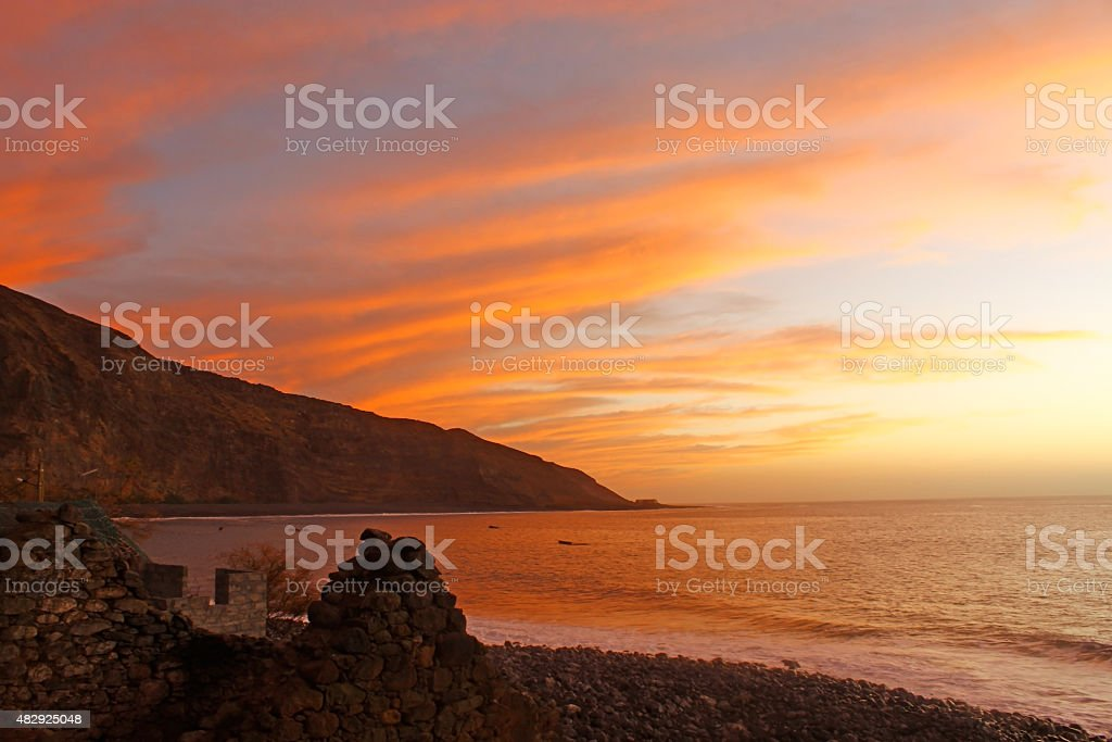 Red sunset over the cliffs and sea landscape stock photo