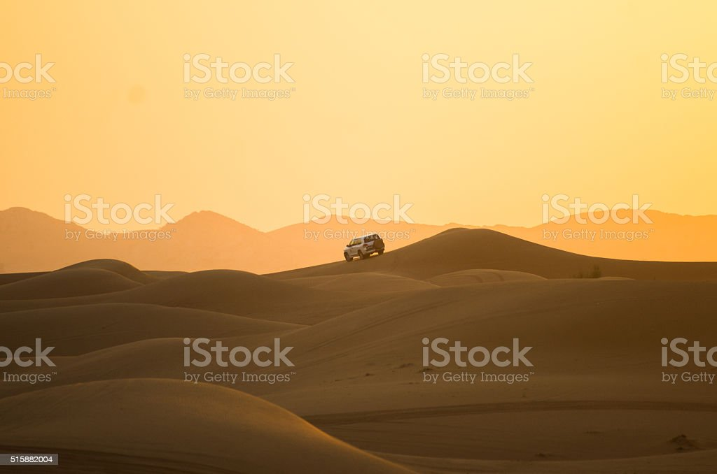 Red sunset over the dunes- Dubai stock photo