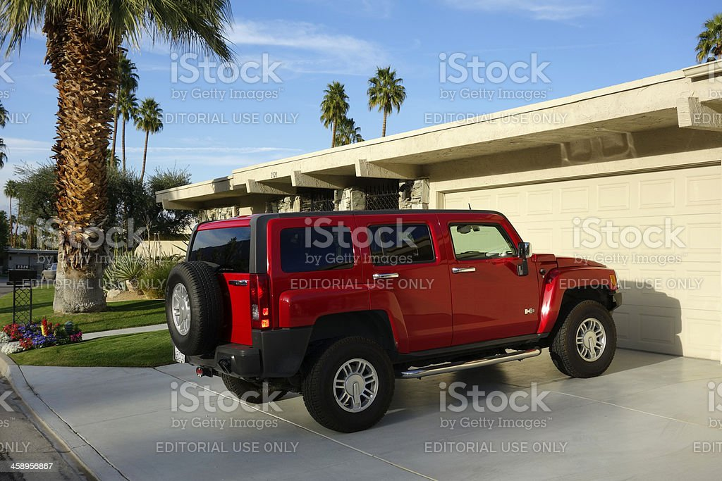 Red SUV Parked On Residential Driveway stock photo