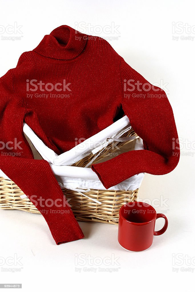 Red sweater in a basket royalty-free stock photo