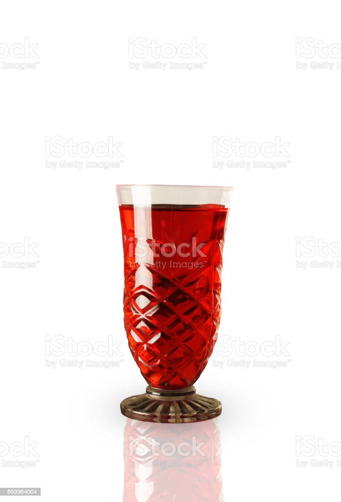 Red sweet refreshing drink in a glass stock photo