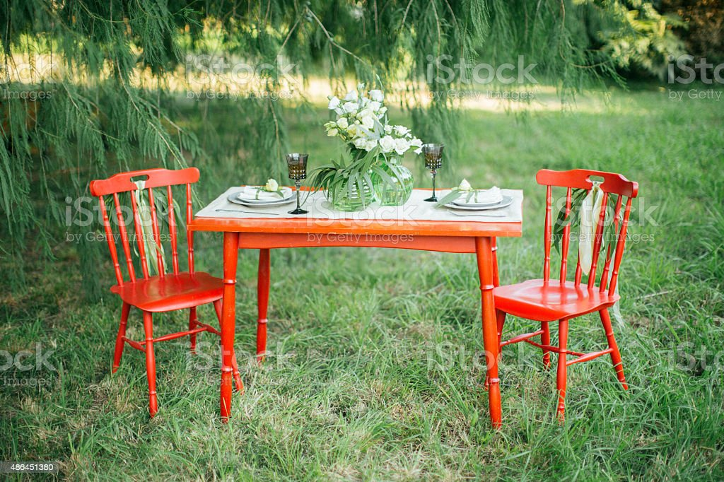 Red table served for two persons stock photo