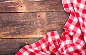 red tablecloth on rustic wooden table