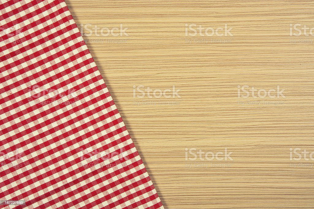 Red tablecloth on wooden table royalty-free stock photo