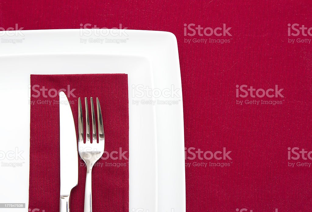 Red tablecloth with white plates royalty-free stock photo