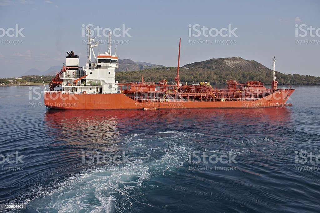 Red Tanker ship in the Mt. Vulcanos's port royalty-free stock photo
