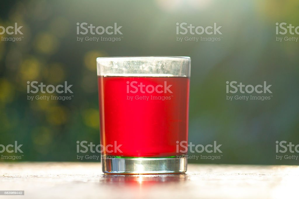 Red tea in a glass mug stock photo