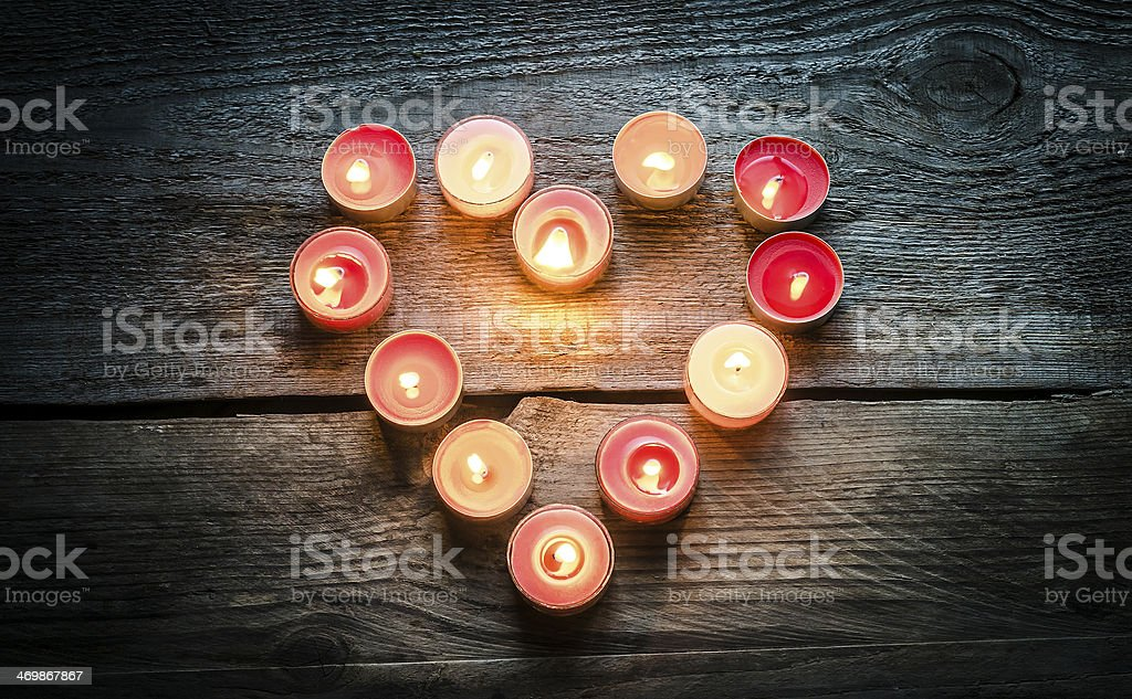 Red tea light candles set out in the shape of a heart stock photo