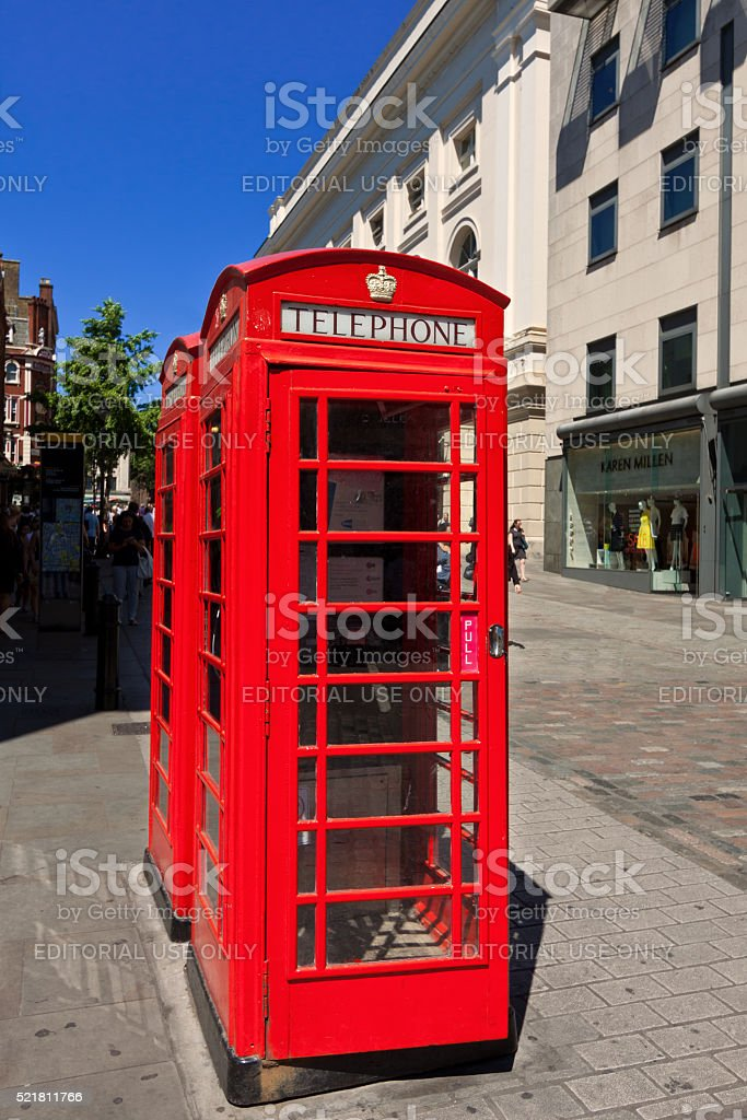 Red Telephone Booth and Vivid Blue Sky, London, England, UK. stock photo