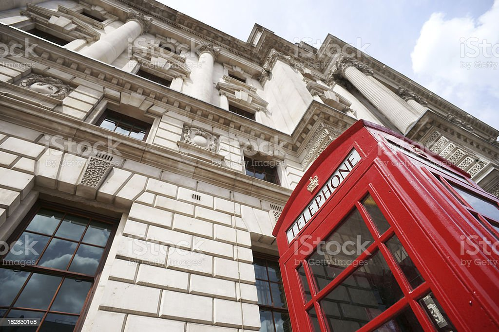 Red telephone booth in London - low angle royalty-free stock photo