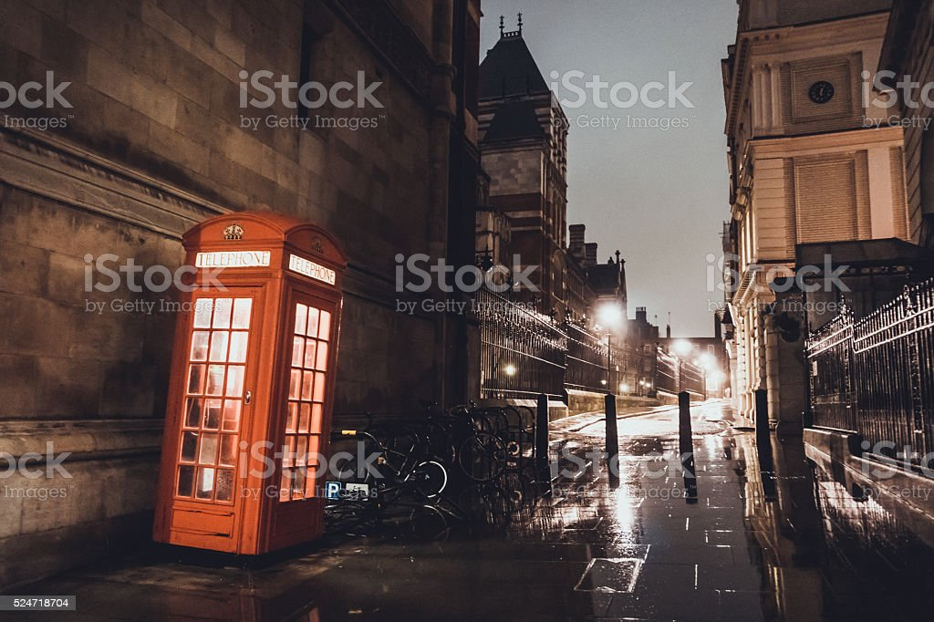 Red telephone booth on a British street stock photo