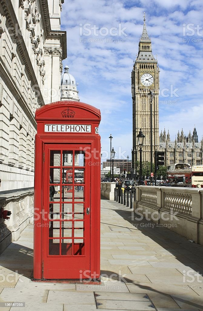 Red telephone booth on the streets of London with Big Ben stock photo