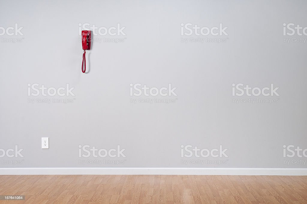 Red Telephone In Empty Room royalty-free stock photo
