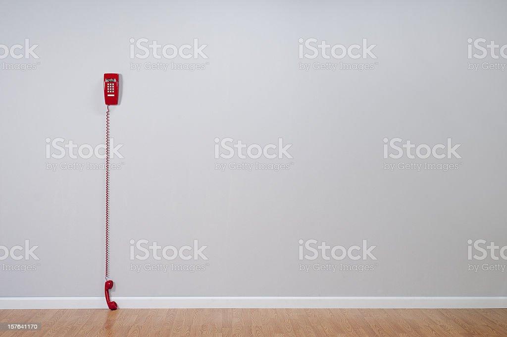 Red Telephone In Empty Room stock photo