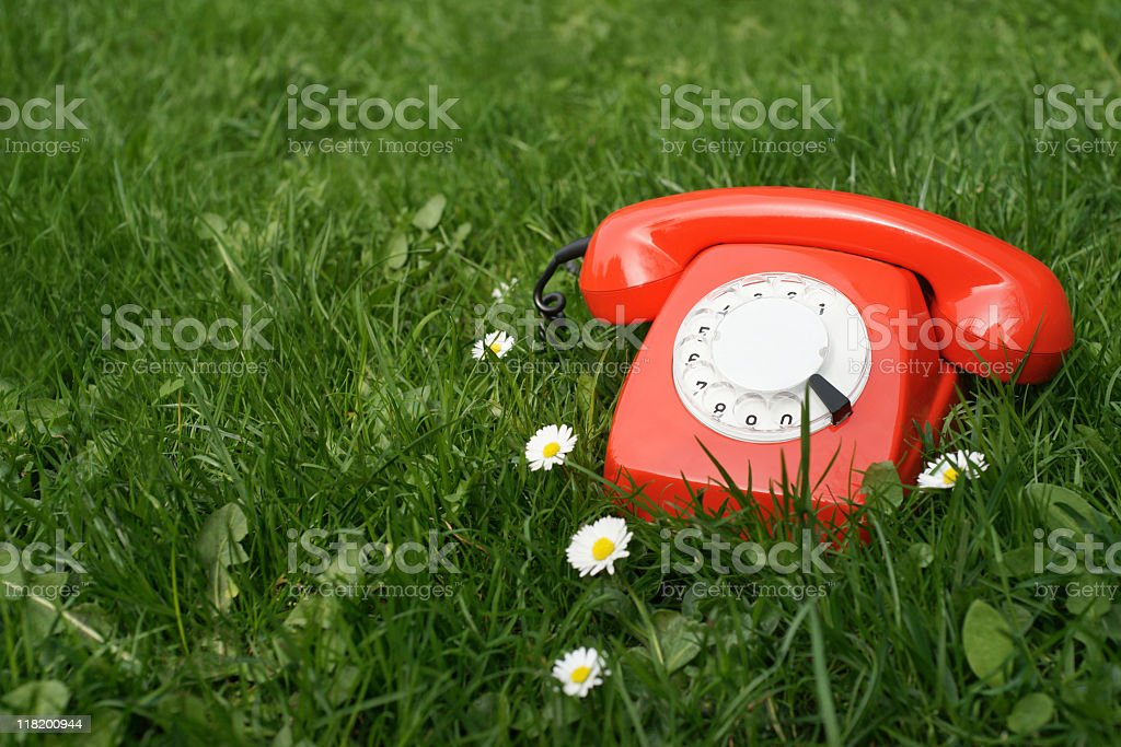 Red Telephone outdoors stock photo