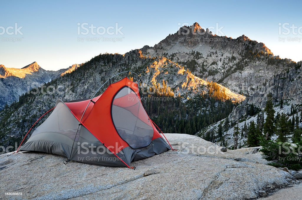A red tent in a backcountry campsite royalty-free stock photo