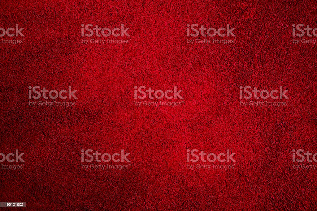 Red textured background with bright center spotlight and dark vi stock photo