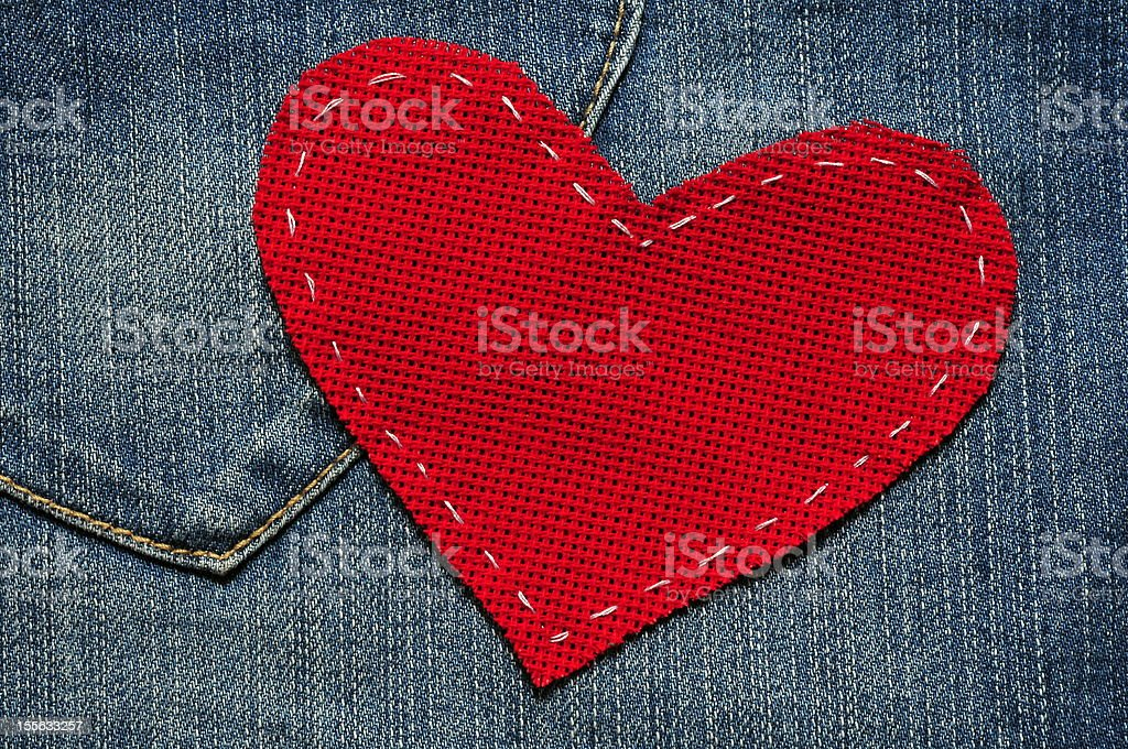 Red textured heart on jeans background royalty-free stock photo