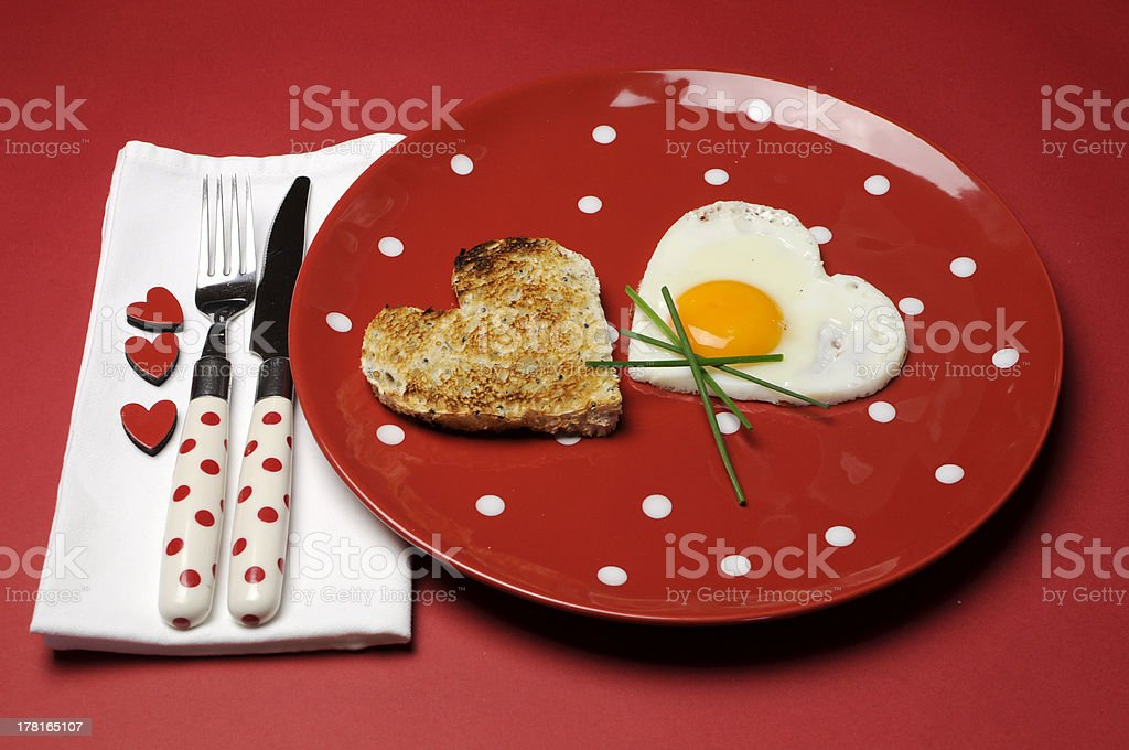 Red theme breakfast with heart shape egg and toast. royalty-free stock photo