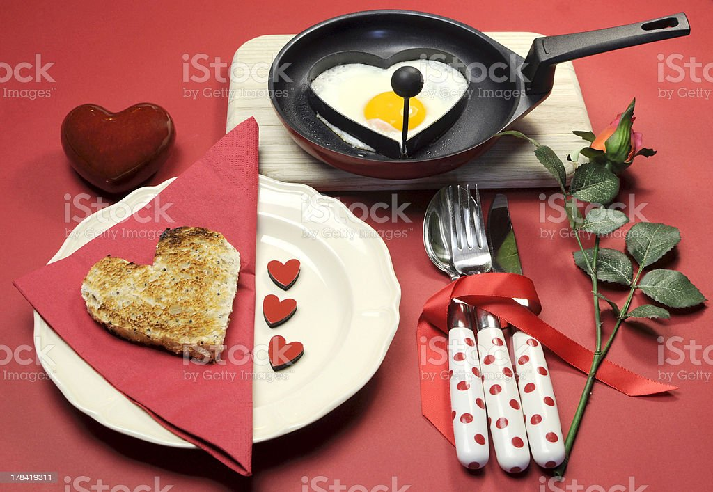 Red theme Valentine breakfast with heart shape egg and toast royalty-free stock photo