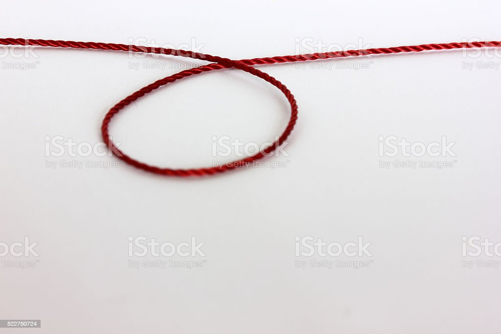 Red thread on white background stock photo