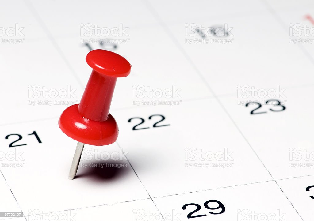 Red Thumb Tack on Calendar Page stock photo