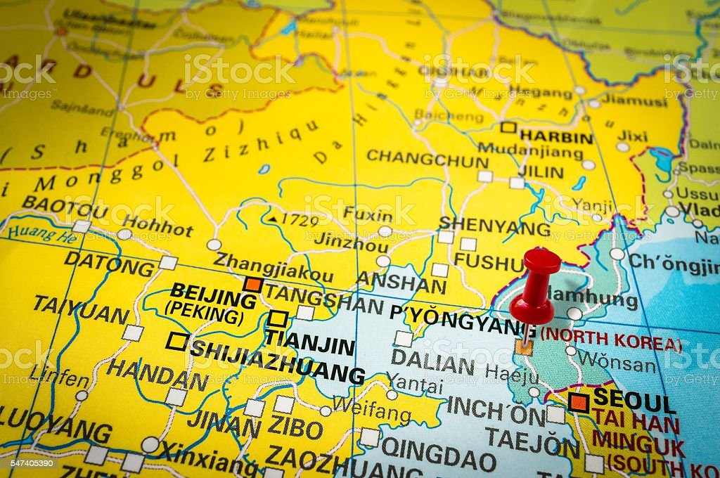 Red thumbtack in a map, pushpin pointing at Pyongyang stock photo