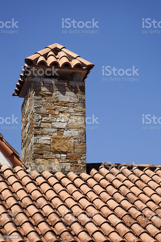 Red tile roof and chimney. royalty-free stock photo