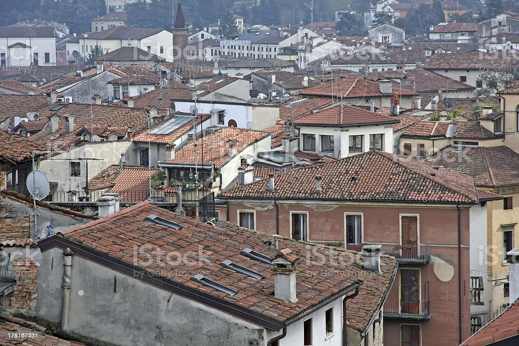 red tile rooftops and houses in an old Italian town royalty-free stock photo