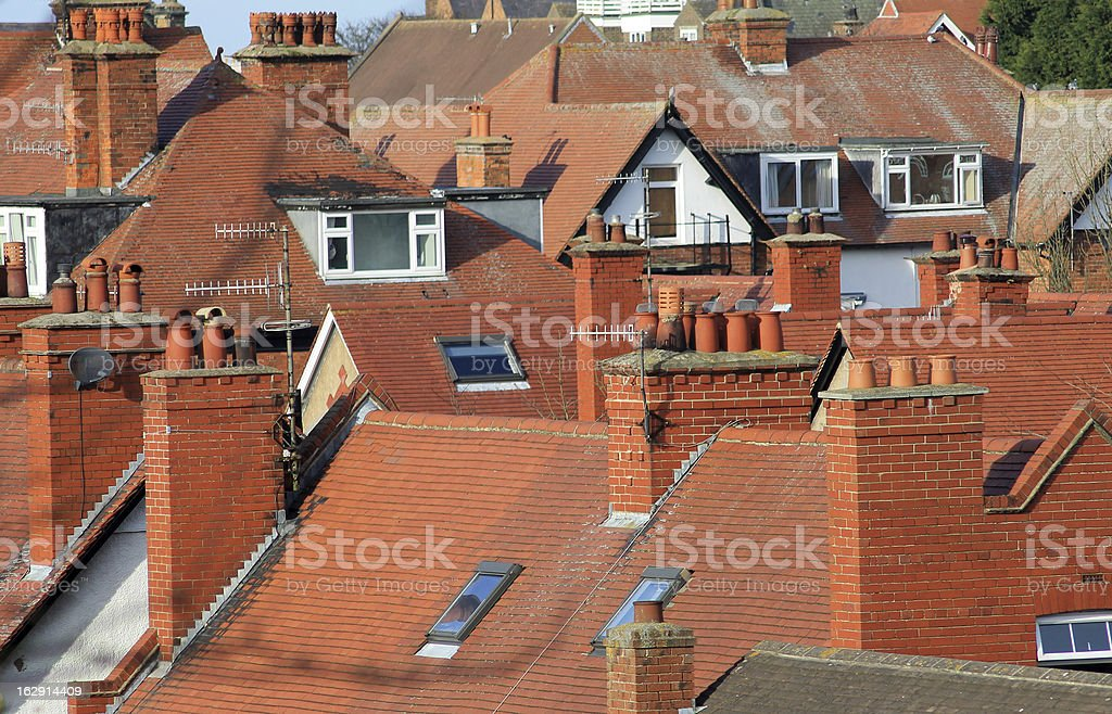 Red tiled roofs of modern houses royalty-free stock photo