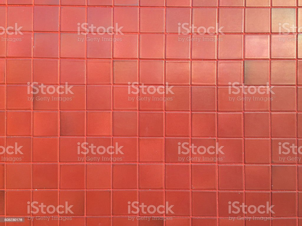 Red tiles wall pattern stock photo