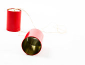 Red tin can phone isolated on white background