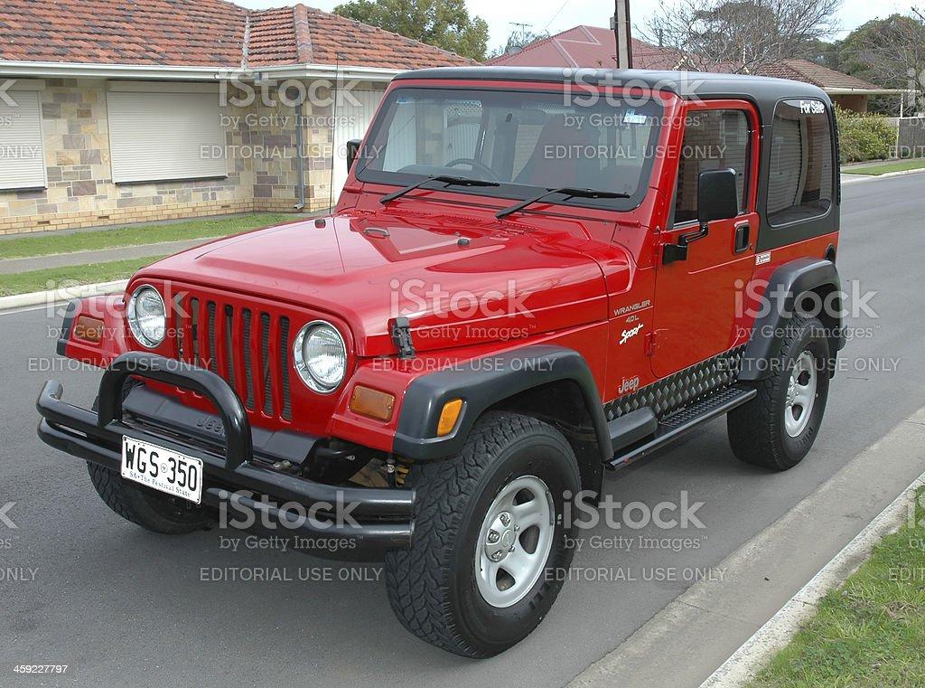 Red TJ 1997 Jeep Wrangler hardtop on street stock photo